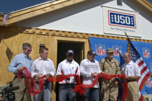 veterans at uso event cutting some kind of ribbon