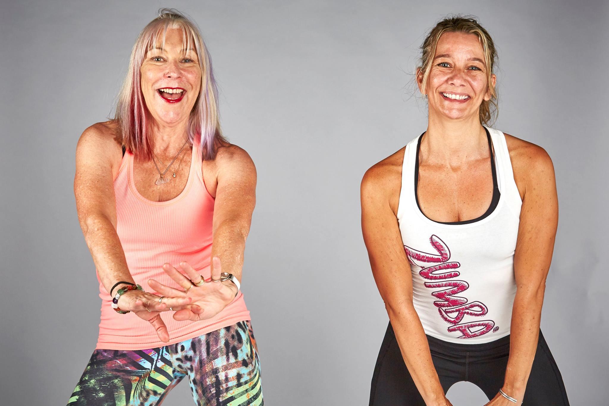 two women facing camera doing a dance routine