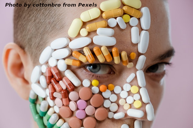 terson with pills covering right side of face