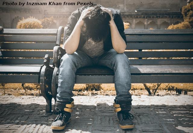 sad man on park bench