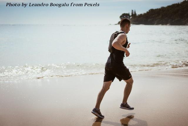 man jogging on beach
