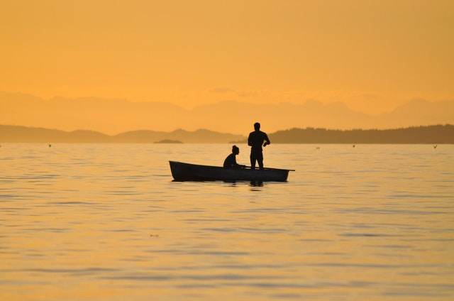 two people on rowboat