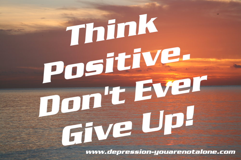 the words think positive. don't ever give up. ove ocean sunrise (copyrighted)