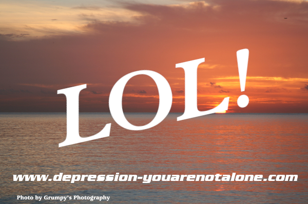 the letters LOL! over ocean sunrise